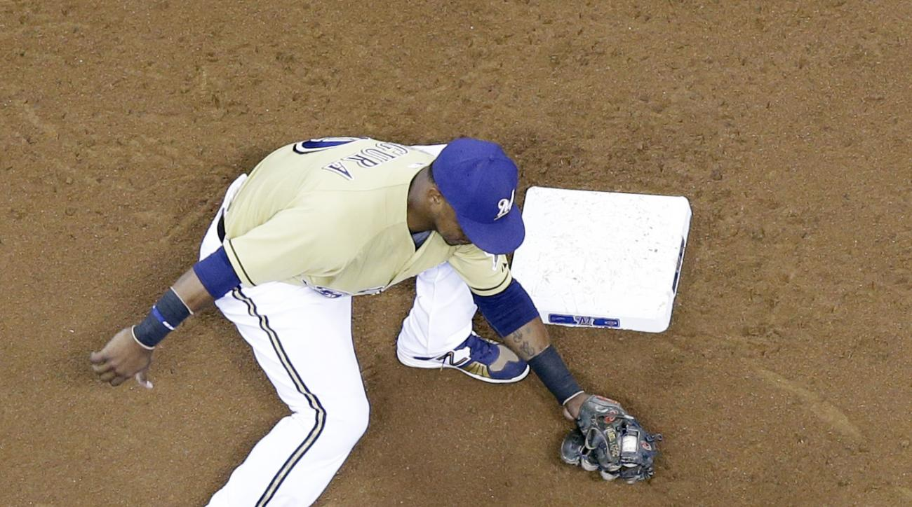 Milwaukee Brewers' Jean Segura tags out Chicago Cubs' Austin Jackson as he is caught stealing second during the third inning of a baseball game Sunday, Oct. 4, 2015, in Milwaukee. (AP Photo/Morry Gash)
