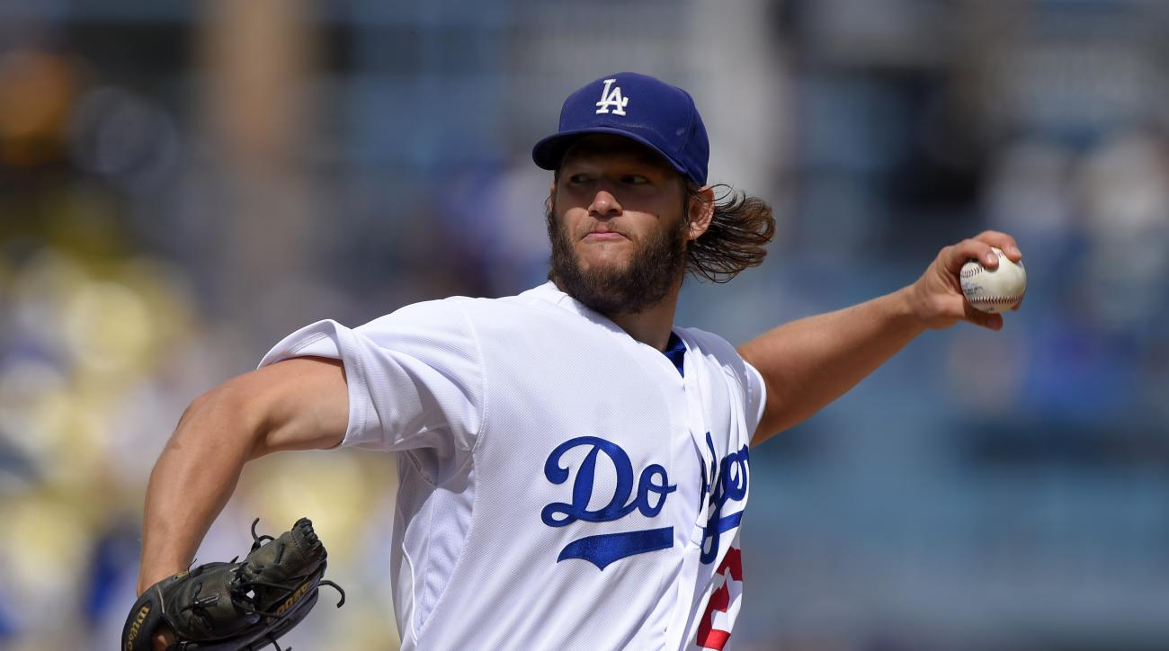 Los Angeles Dodgers starting pitcher Clayton Kershaw throws to the plate during the first inning of a baseball game against the San Diego Padres, Sunday, Oct. 4, 2015, in Los Angeles. (AP Photo/Mark J. Terrill)