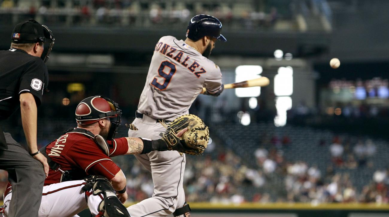 Houston Astros' Marwin Gonzalez (9) hits a line drive single against the Arizona Diamondbacks during the second inning of a baseball game, Sunday, Oct. 4, 2015, in Phoenix. (AP Photo/Ralph Freso)