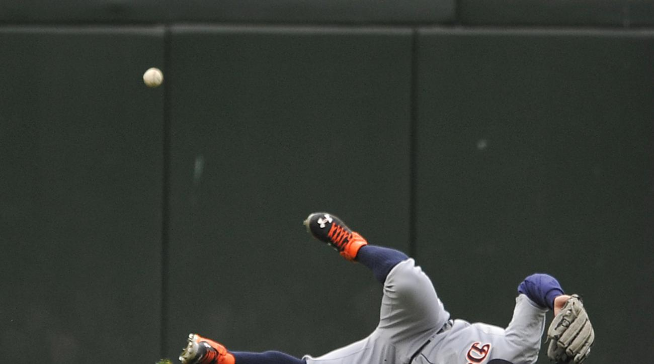 Detroit Tigers left fielder Tyler Collins (18), misses a triple hit by Chicago White Sox's Trayce Thompson during the fourth inning of a baseball game Sunday, Oct. 4, 2015 in Chicago. (AP Photo/Paul Beaty)