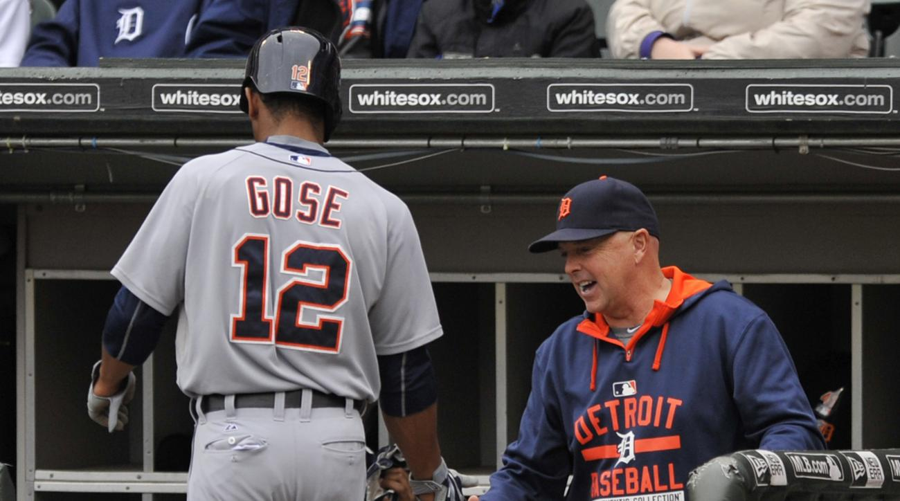 Detroit Tigers' Anthony Gose (12), celebrates with hitting coach Wally Joyner right, in the dugout after scoring on a Nick Castellanos double during the first inning of a baseball game Sunday, Oct. 4, 2015 in Chicago. (AP Photo/Paul Beaty)
