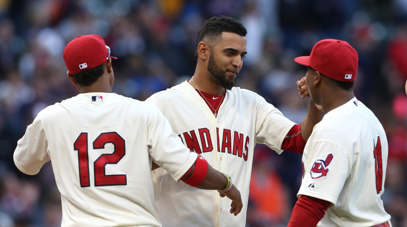 Cleveland Indians starting pitcher Danny Salazar, center, celebrates with Francisco Lindor, left, and Jose Ramirez after a 3-1 Indians win over the Boston Red Sox in a baseball game, Sunday, Oct. 4, 2015, in Cleveland. (AP Photo/Ron Schwane)