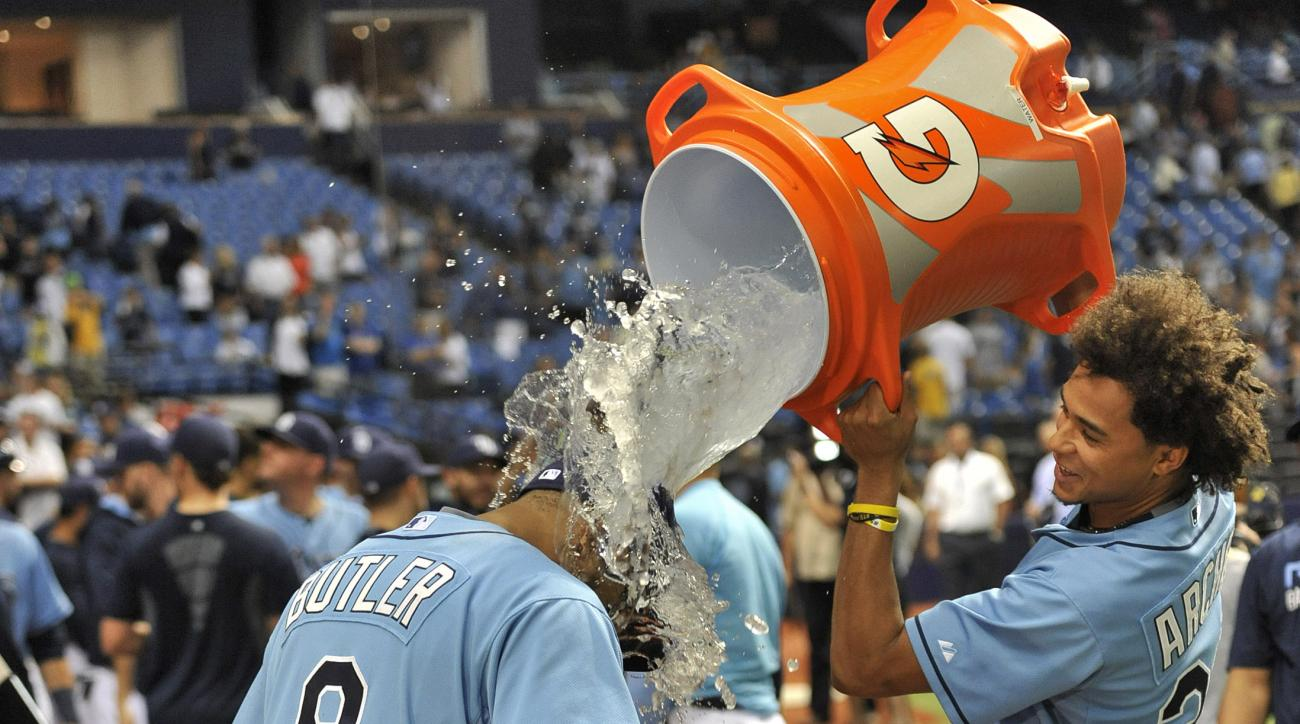 Tampa Bay Rays' Chris Archer, right, dumps a cooler onto Joey Butler at  the end of a baseball game against the Toronto Blue Jays Sunday, Oct. 4, 2015, in St. Petersburg, Fla. Butler hit two home runs and six RBIs in a 12-3 win over the Blue Jays. (AP Pho