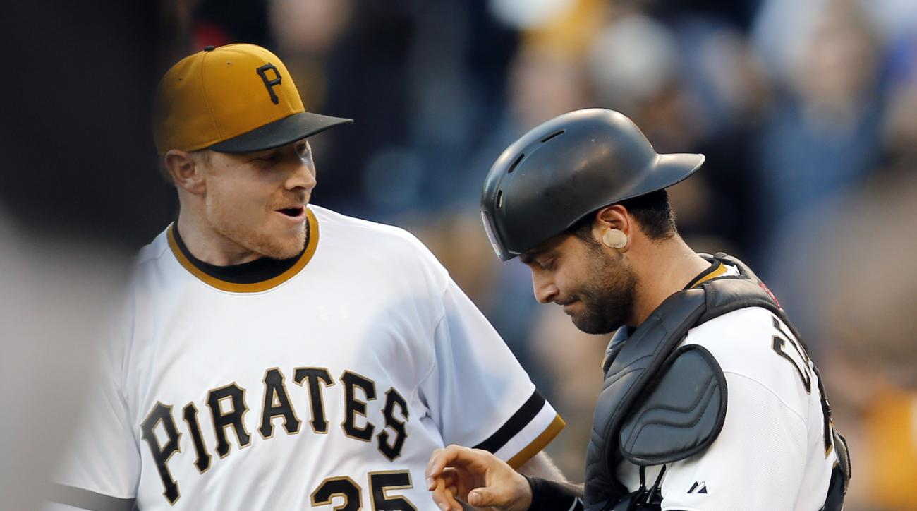 Pittsburgh Pirates relief pitcher Mark Melancon (35) greets catcher Francisco Cervelli after getting the last out in the ninth inning of a baseball game against the Cincinnati Reds, Sunday, Oct. 4, 2015, in Pittsburgh. The Pirates won 4-0 and clenched the