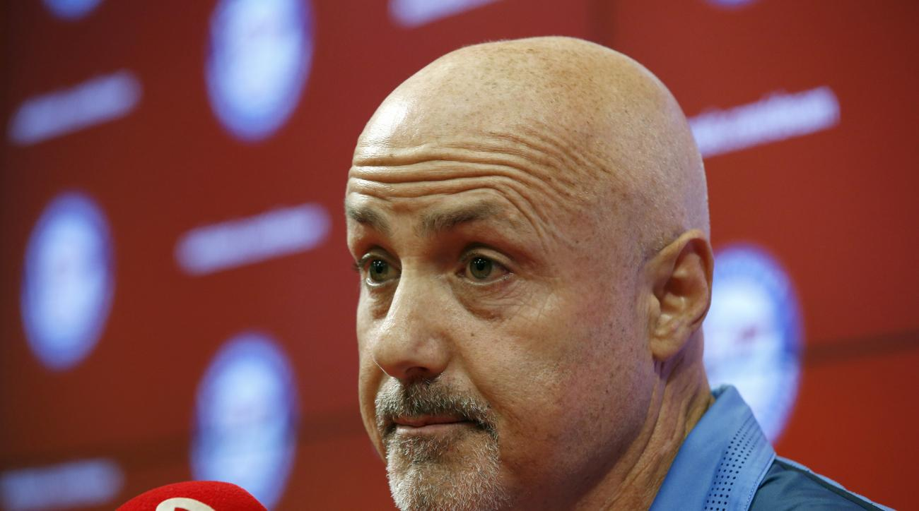 FILE - In this Sept. 28, 2105 file photo, Washington Nationals general manager Mike Rizzo pauses while speaking after a baseball game against the Cincinnati Reds at Nationals Park in Washington. Before the season began, no one was shy about predicting big