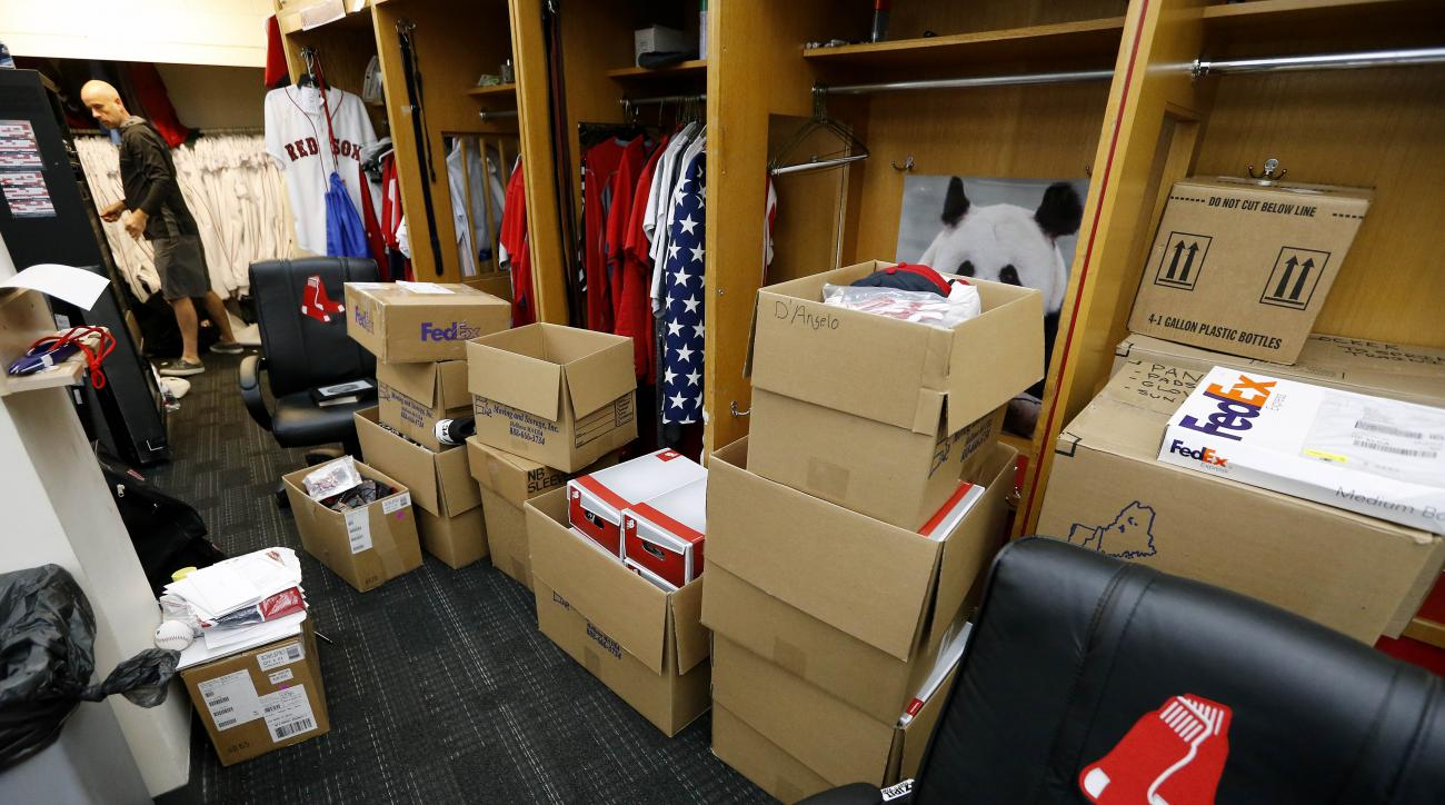 An attendant works to stow equipment in the club house at Fenway Park in Boston, Monday, Oct. 5, 2015, a day after the Boston Red Sox finished the baseball season in last place in the American League East. (AP Photo/Michael Dwyer)