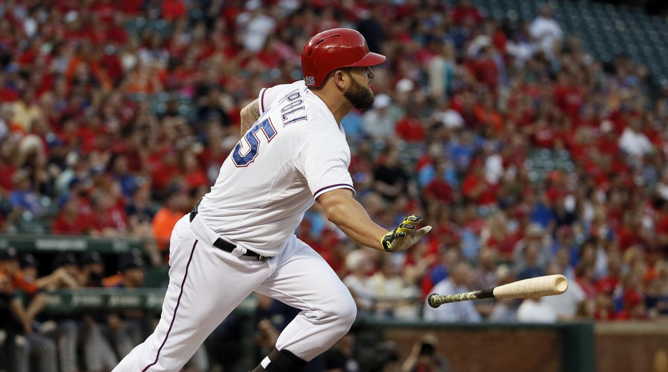 FILE - In this Sept. 16, 2015, file photo, Texas Rangers' Mike Napoli drops his bat on a three-run home run off Houston Astros' Dallas Keuchel during the first inning of a baseball game in Arlington, Texas. The Rangers are back in the playoffs two months
