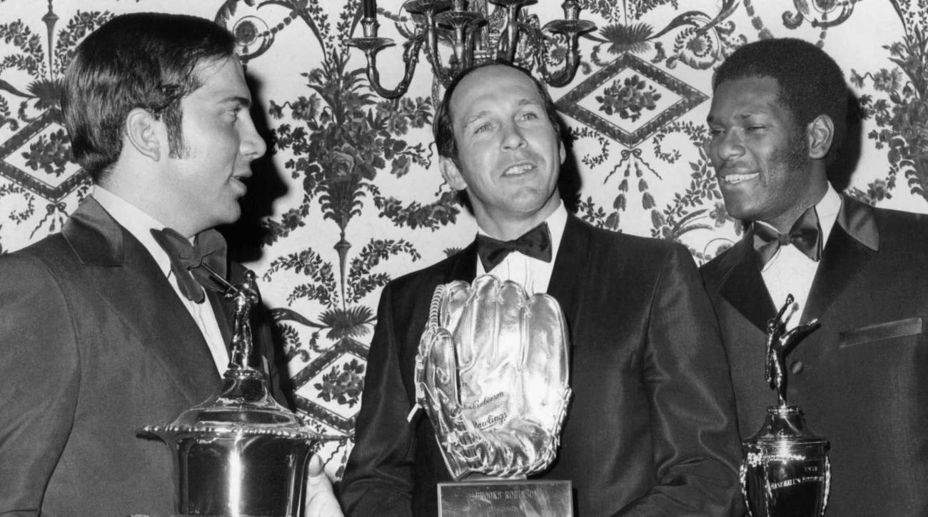 FILE - In this Dec. 4, 1970, file photo, from left, Cincinnati's Johnny Bench, Baltimore's Brooks Robinson and St. Louis Cardinals' Bob Gibson pose with awards at Baseball's 1970 Awards Dinner in Los Angeles.  Brooks Robinson spent decades surrounded by t