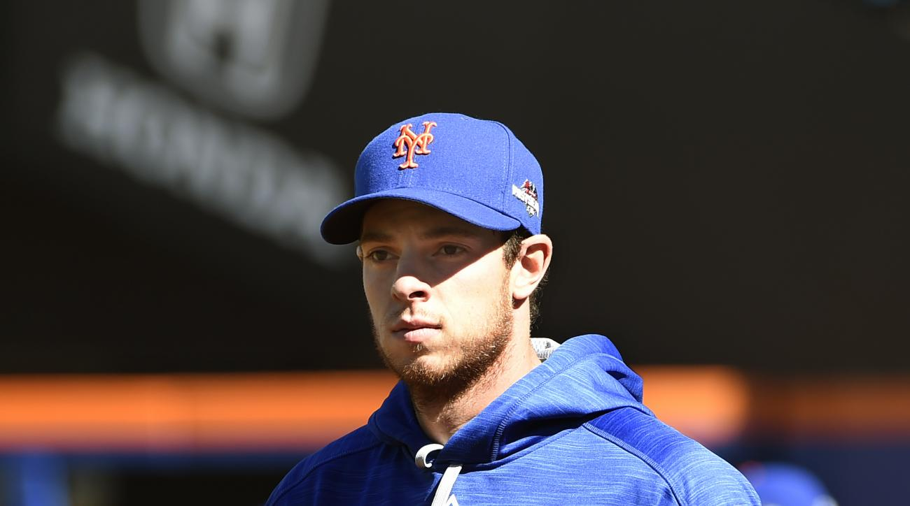 New York Mets starting pitcher Steven Matz walks the field during practice at Citi Field for the NLDS series against the Los Angeles Dodgers, Tuesday, Oct. 6, 2015, in New York.  (AP Photo/Kathy Kmonicek)