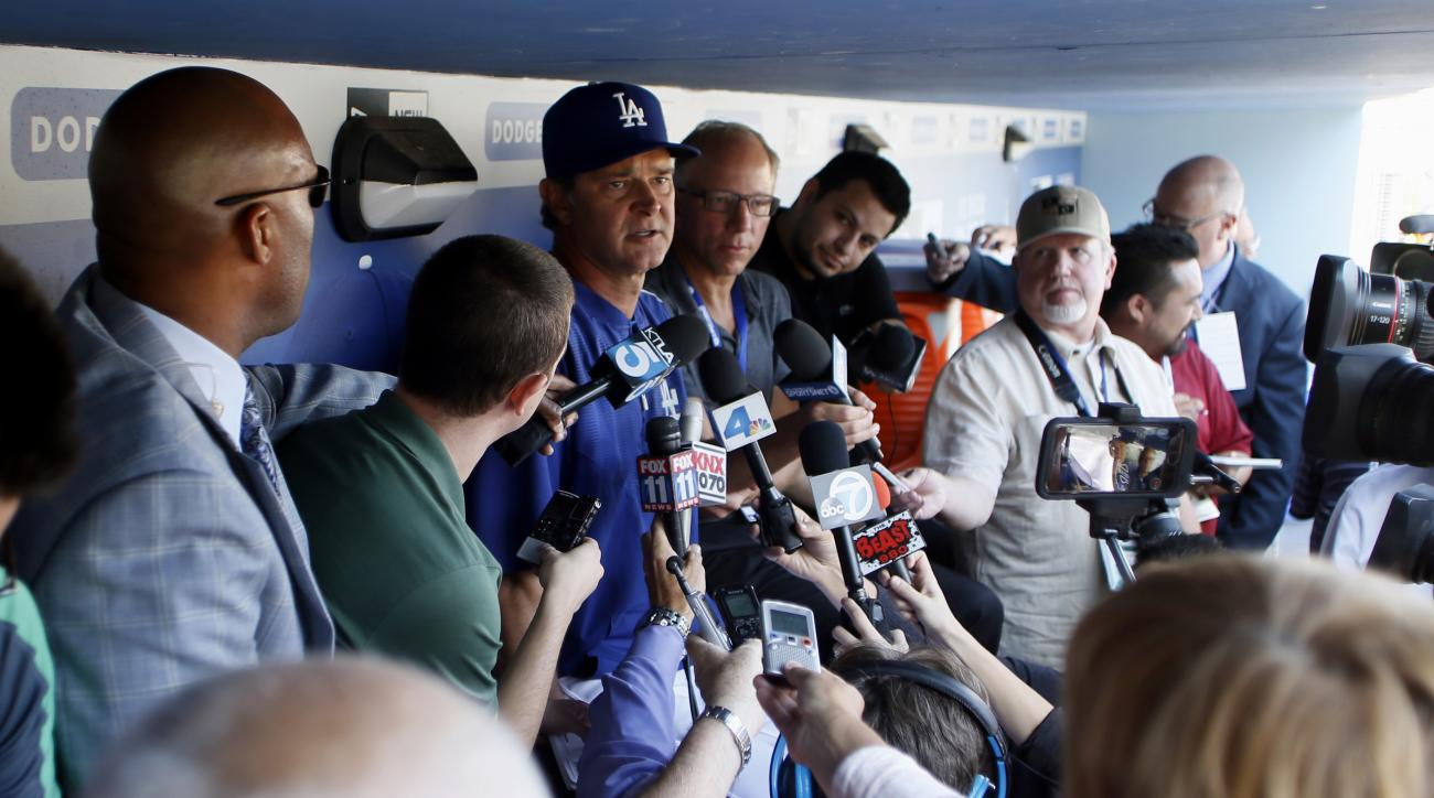 Los Angeles Dodgers manager Don Mattingly answers questions from the media during practice for the upcoming NLDS playoff baseball series against the New York Mets, Tuesday, Oct. 6, 2015, in Los Angeles. Their NLDS best of five playoff series begins Friday