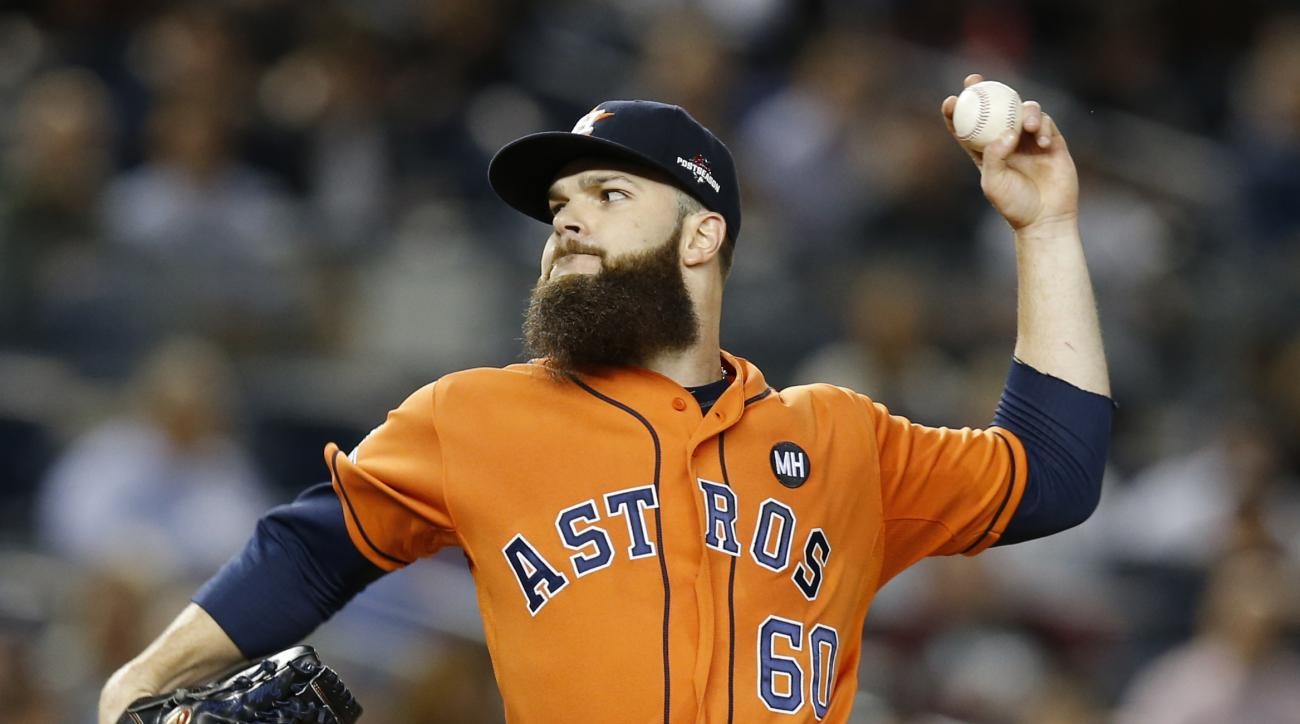 Houston Astros starting pitcher Dallas Keuchel pitches in the first inning of the American League wild card baseball game against the New York Yankees at Yankee Stadium in New York, Tuesday, Oct. 6, 2015.  (AP Photo/Kathy Willens)