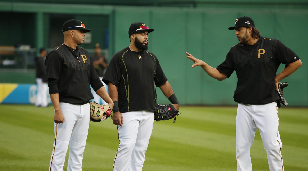 Pittsburgh Pirates first basemen Pedro Alvarez, center, Aramis Ramirez, left, and Sean Rodriguez, right, stand beside each other during batting practice before the National League Wild Card baseball game against the Chicago Cubs, Wednesday, Oct. 7, 2015,