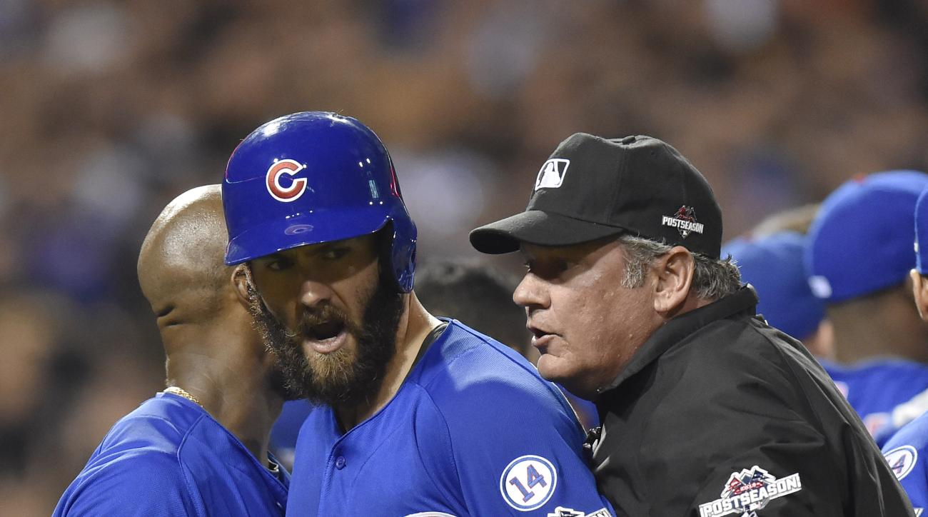 Chicago Cubs starting pitcher Jake Arrieta, center, is pulled away from a scrum by first base umpire Hunter Wendelstedt after he was hit by a pitch by Pittsburgh Pirates relief pitcher Tony Watson in the seventh inning of the National League wild card bas