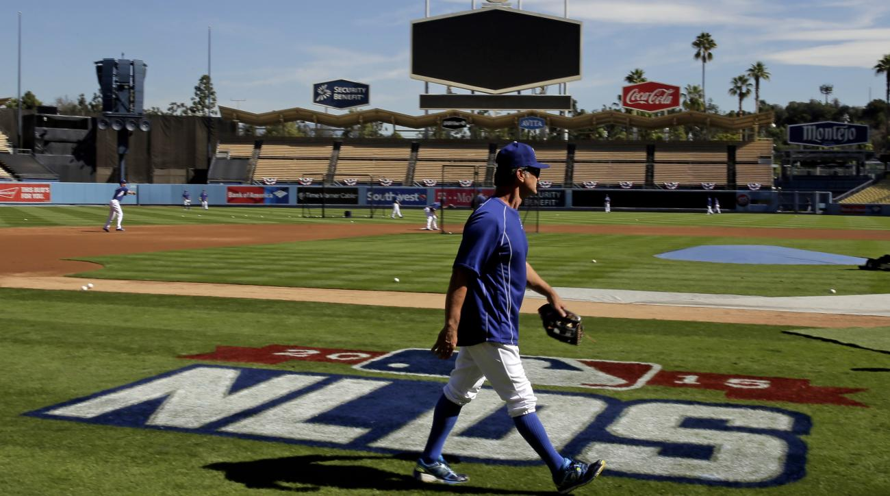 Los Angeles Dodgers manager Don Mattingly watches during batting practice in preparation for the National League Division Series that is set to begin on Friday against the New York Mets, Thursday, Oct. 8, 2015 in Los Angeles. (AP Photo/Chris Carlson)
