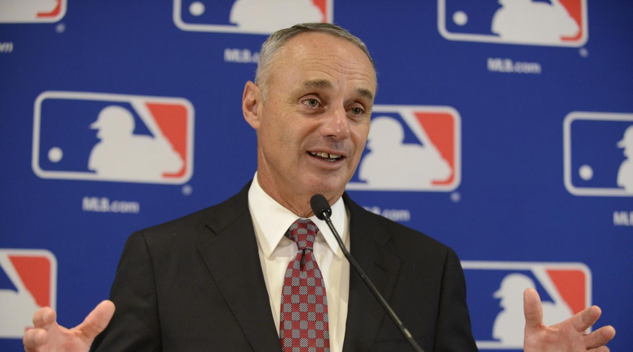 """FILE - In this Aug. 13, 2015, file photo, Major League Baseball Commissioner Rob Manfred speaks to the media after the owners meetings in Chicago. Manfred says it's """"not appropriate"""" to enforce pace-of-play rules as strictly during the postseason. Speakin"""