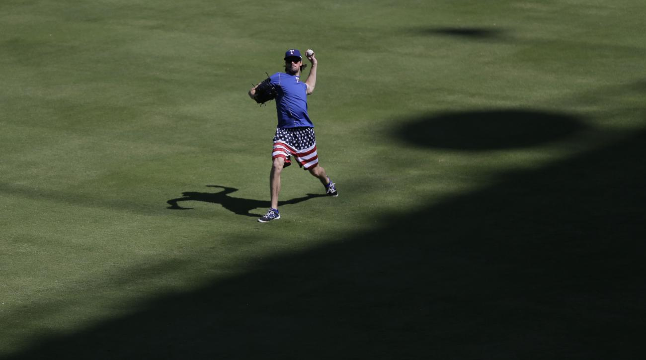 Texas Rangers' Cole Hamels throws during an American League Division Series baseball practice, Saturday, Oct. 10, 2015, in Arlington, Texas. The Rangers will face the Toronto Blue Jays in game 3 Sunday. (AP Photo/Eric Gay)