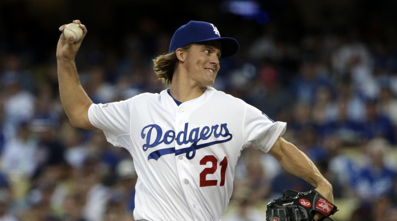 Los Angeles Dodgers starting pitcher Zack Greinke throws to the New York Mets during the first inning in Game 2 of baseball's National League Division Series, Saturday, Oct. 10, 2015 in Los Angeles. (AP Photo/Lenny Ignelzi)