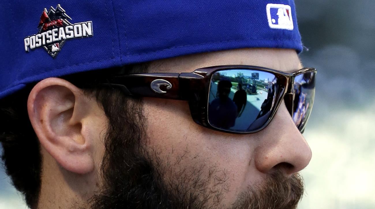 Chicago Cubs pitcher Jake Arrieta talks with teammates before an NLDS baseball practice on Sunday, Oct. 11, 2015, in Chicago. The Cubs are to face the St. Louis Cardinals in Game 3 of the National League Division Series on Monday. (AP Photo/Nam Y. Huh)