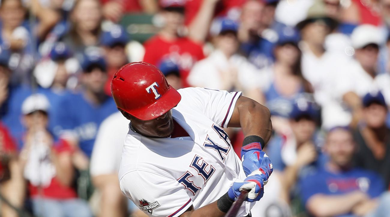 Texas Rangers third baseman Adrian Beltre (29) singles against the Toronto Blue Jays inning in Game 4 of baseball's American League Division Series Monday, Oct. 12, 2015, in Arlington, Texas. (AP Photo/Tony Gutierrez)