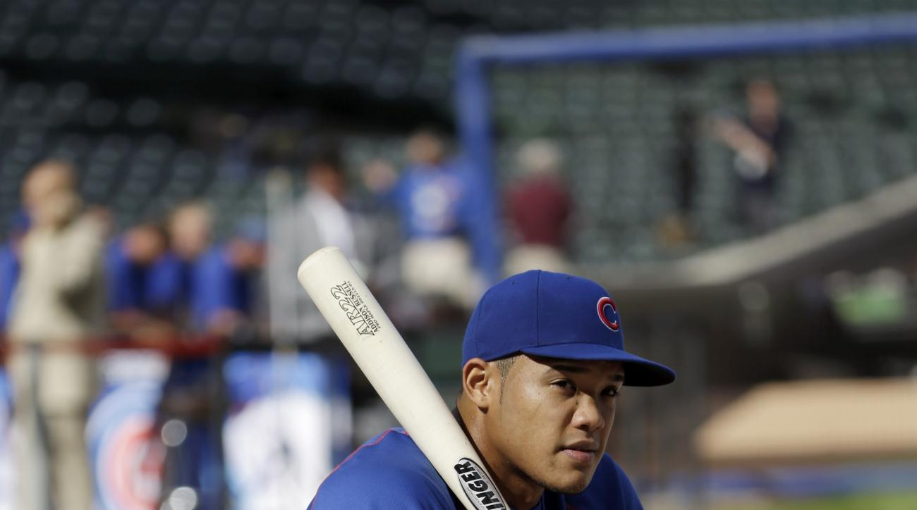Chicago Cubs' Addison Russell (22) watches batting practice before Game 3 in baseball's National League Division Series against the St. Louis Cardinals, Monday, Oct. 12, 2015, in Chicago. (AP Photo/Nam Y. Huh)