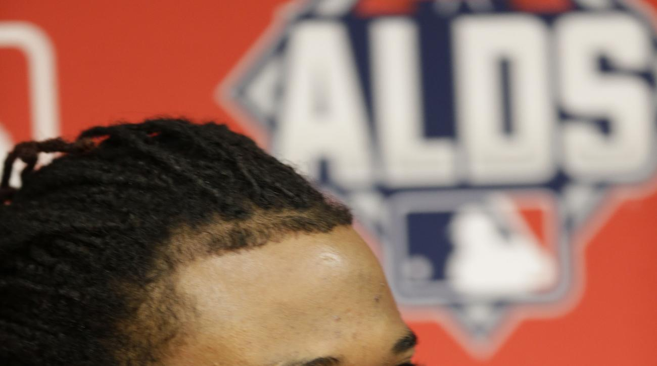 Kansas City Royals starting pitcher Johnny Cueto smiles during a news conference at Kauffman Stadium in Kansas City, Mo., Tuesday, Oct. 13, 2015. The Royals will play the Houston Astros Wednesday in the 5th baseball game of the ALDS. (AP Photo/Orlin Wagne