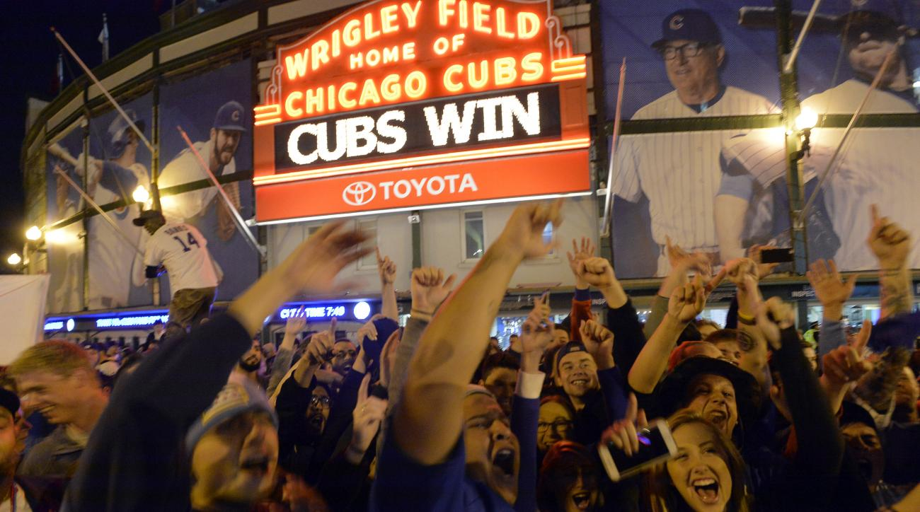 Fans gather on the streets outside of Wrigley Field after the Cubs won 6-4 in Game 4 in baseball's National League Division Series against the St. Louis Cardinals, Tuesday, Oct. 13, 2015, in Chicago. (AP Photo/Paul Beaty)