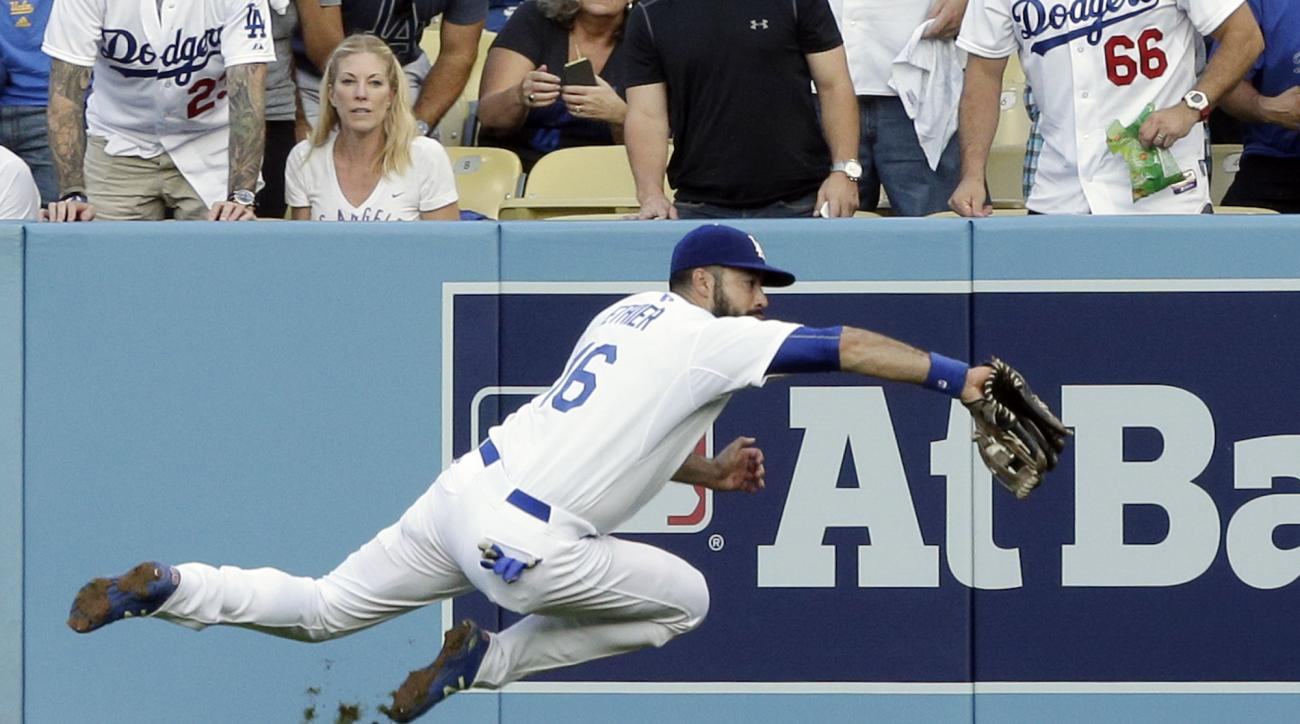 Los Angeles Dodgers right fielder Andre Ethier catches a ball hit by the New York Mets' Michael Conforto during the second inning in Game 5 of baseball's National League Division Series Thursday, Oct. 15, 2015, in Los Angeles. (AP Photo/Alex Gallardo)