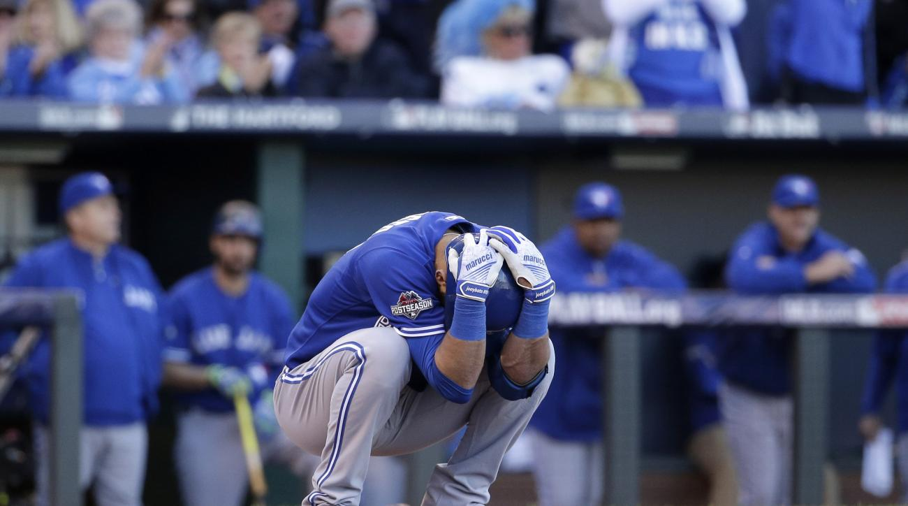 Toronto Blue Jays' Jose Bautista reacts after striking out against the Kansas City Royals to end the top of the seventh inning in Game 2 of baseball's American League Championship Series on Saturday, Oct. 17, 2015, in Kansas City, Mo. (AP Photo/Charlie Ri
