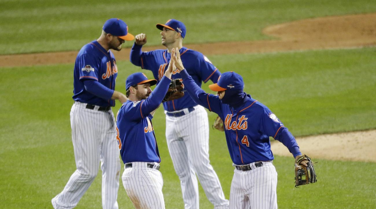 New York Mets players celebrate after Game 2 of the National League baseball championship series against the Chicago Cubs Sunday, Oct. 18, 2015, in New York. The Mets won 4-1 to take a 2-0 lead in the series. (AP Photo/David Goldman)