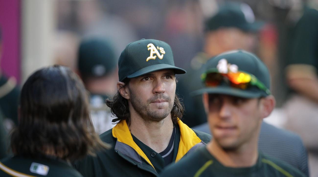 Oakland Athletics starting pitcher Barry Zito, center, walks through the dugout during the fifth inning of a baseball game against the Los Angeles Angels, Wednesday, Sept. 30, 2015, in Anaheim, Calif. (AP Photo/Jae C. Hong)