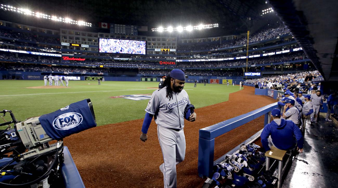 Kansas City Royals starting pitcher Johnny Cueto walks into the dugout after being taken out of the game against the Toronto Blue Jays during the third inning in Game 3 of baseball's American League Championship Series on Monday, Oct. 19, 2015, in Toronto