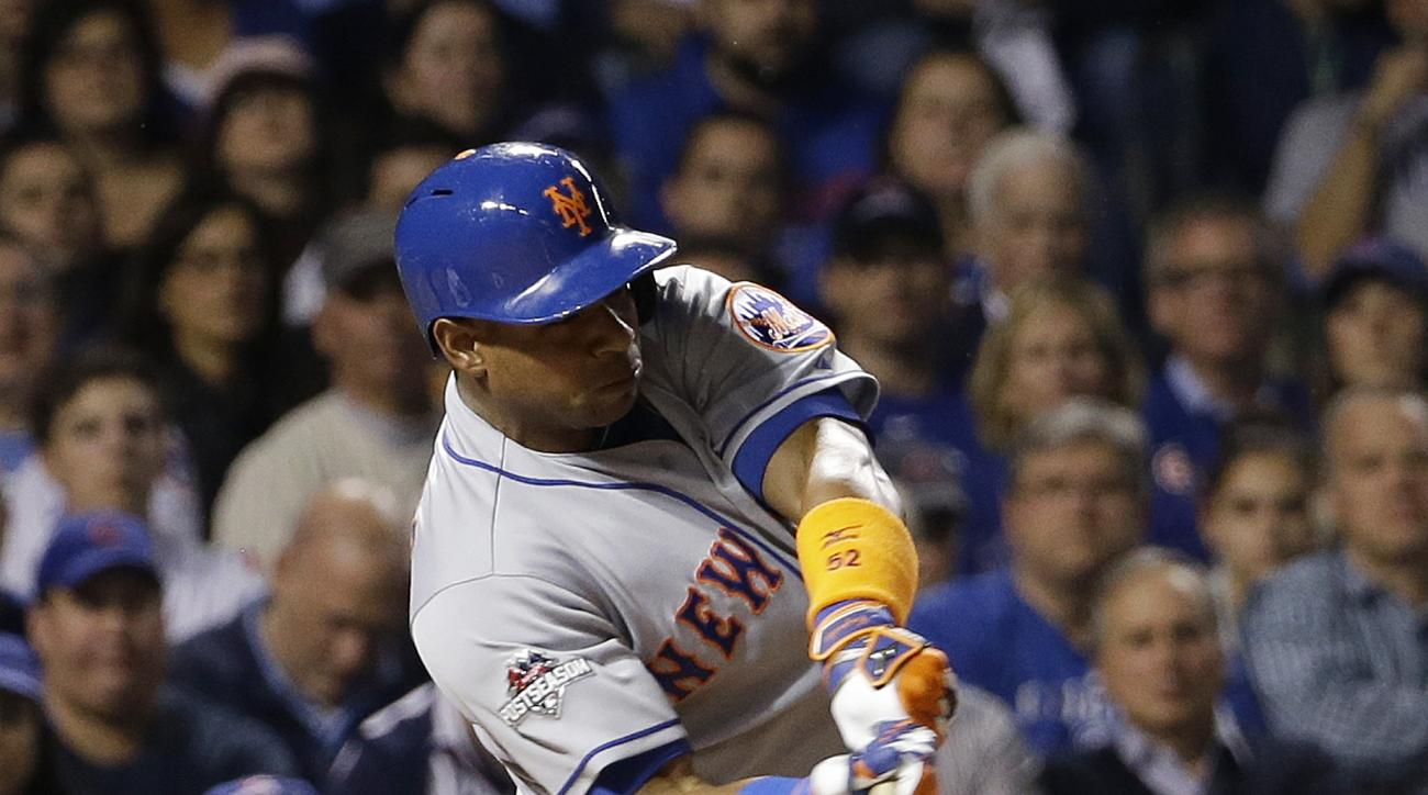 New York Mets' Yoenis Cespedes hits an RBI double during the first inning of Game 3 of the National League baseball championship series against the Chicago Cubs Tuesday, Oct. 20, 2015, in Chicago. (AP Photo/David J. Phillip)