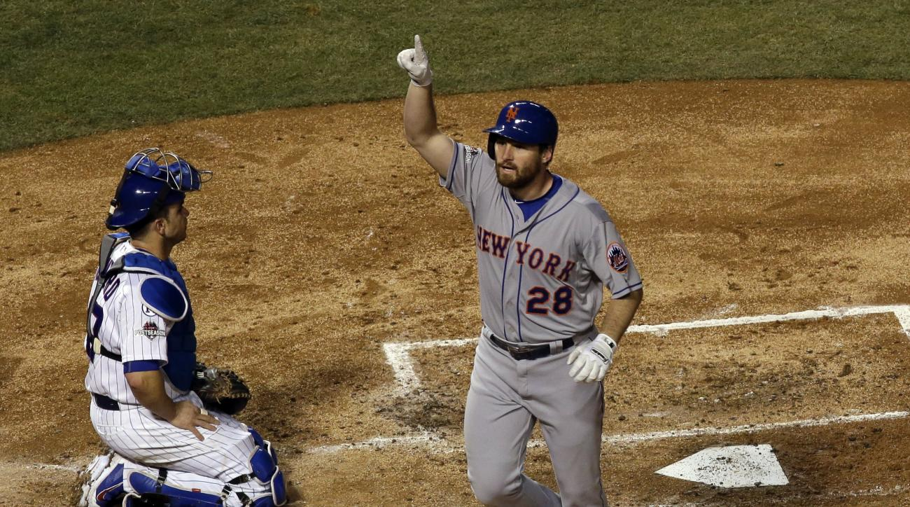 New York Mets' Daniel Murphy celebrates after hitting a home run during the third inning of Game 3 of the National League baseball championship series against the Chicago Cubs Tuesday, Oct. 20, 2015, in Chicago. (AP Photo/David J. Phillip)