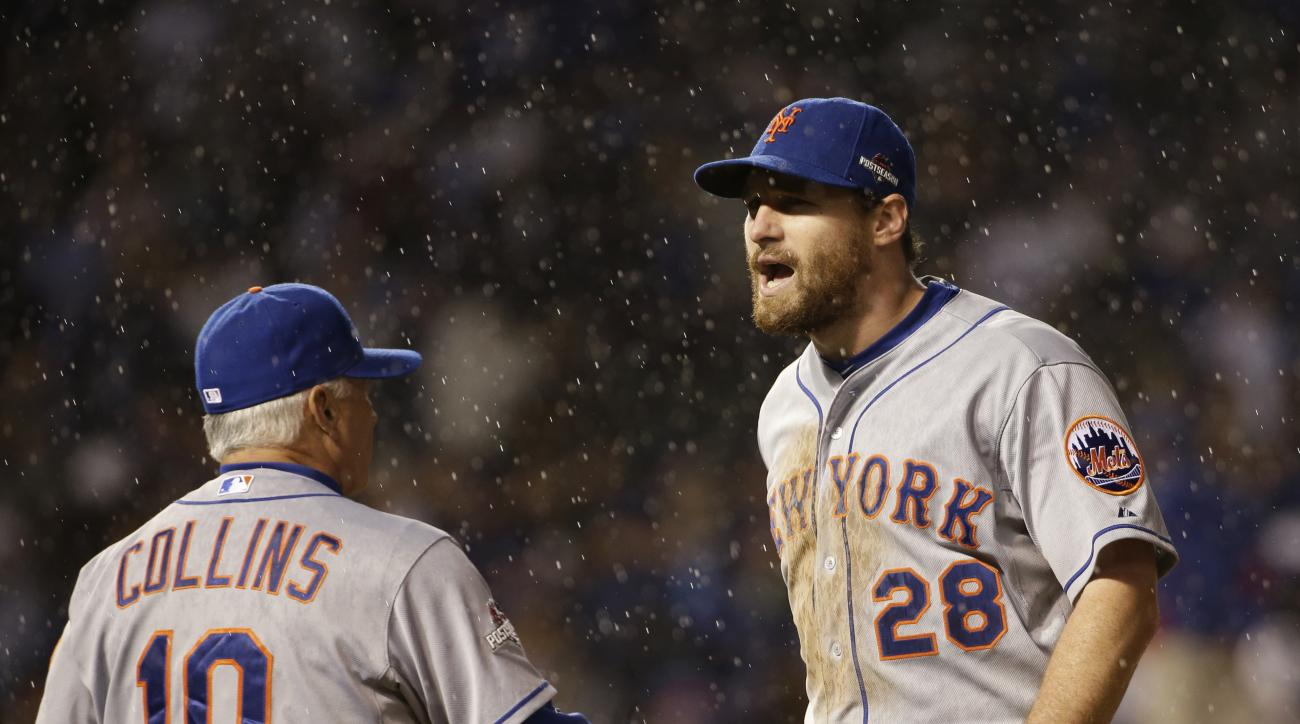 New York Mets' Daniel Murphy (28) is congratulated by manager Terry Collins after Game 3 of the National League baseball championship series against the Chicago Cubs Tuesday, Oct. 20, 2015, in Chicago. The Mets won 5-2 to take a 3-0 lead in the series. (A