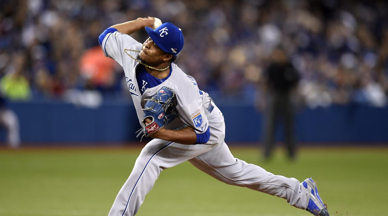 Kansas City Royals starting pitcher Edinson Volquez delivers to the Toronto Blue Jays during the fifth inning in Game 5 of baseball's American League Championship Series in Toronto,  Wednesday, Oct. 21, 2015.  (Frank Gunn/The Canadian Press via AP) MANDAT