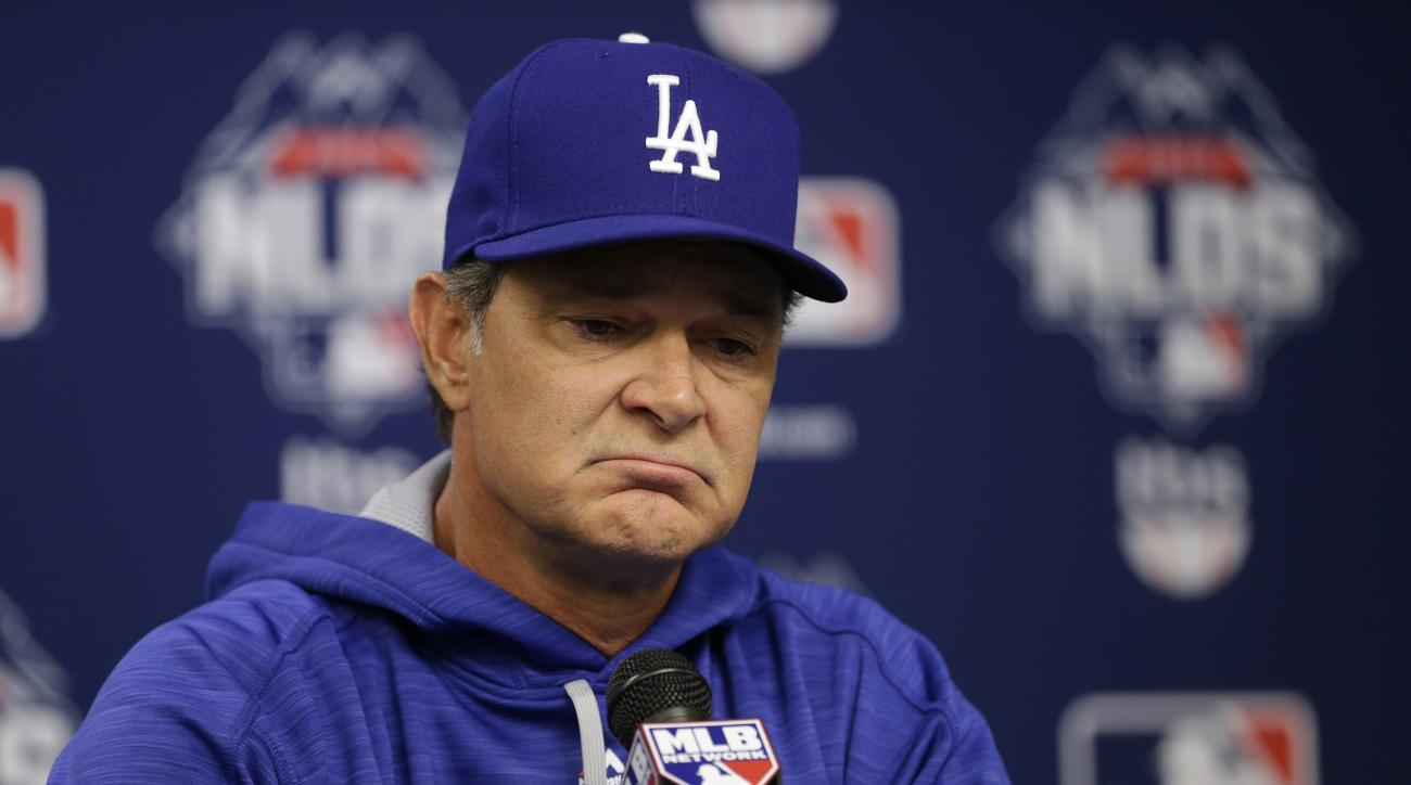 FILE - In this Monday, Oct. 12, 2015, file photo, Los Angeles Dodgers manager Don Mattingly speaks during a news conference before Game 3 of baseball's National League Division Series against the New York Mets in New York. A person familiar with the decis