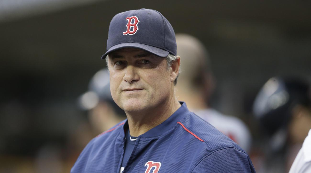 FILE - In this Saturday, Aug. 8, 2015 file photo, Boston Red Sox manager John Farrell is looks out from the dugout during the first inning of a baseball game against the Detroit Tigers in Detroit. The Red Sox say manager John Farrell's cancer is in remiss