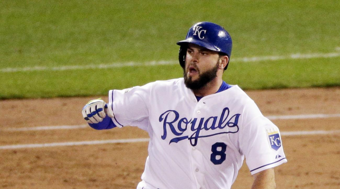 Kansas City Royals' Mike Moustakas celebrates his solo home run against the Toronto Blue Jays during the second inning in Game 6 of baseball's American League Championship Series on Friday, Oct. 23, 2015, in Kansas City, Mo. (AP Photo/Jae C. Hong)