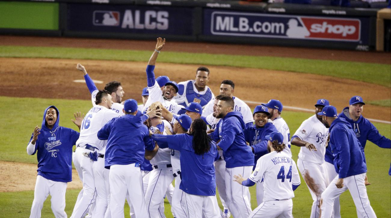 Kansas City Royals celebrates their 4-3 win against the Toronto Blue Jays in Game 6 of baseball's American League Championship Series on Friday, Oct. 23, 2015, in Kansas City, Mo.(AP Photo/Jae C. Hong)