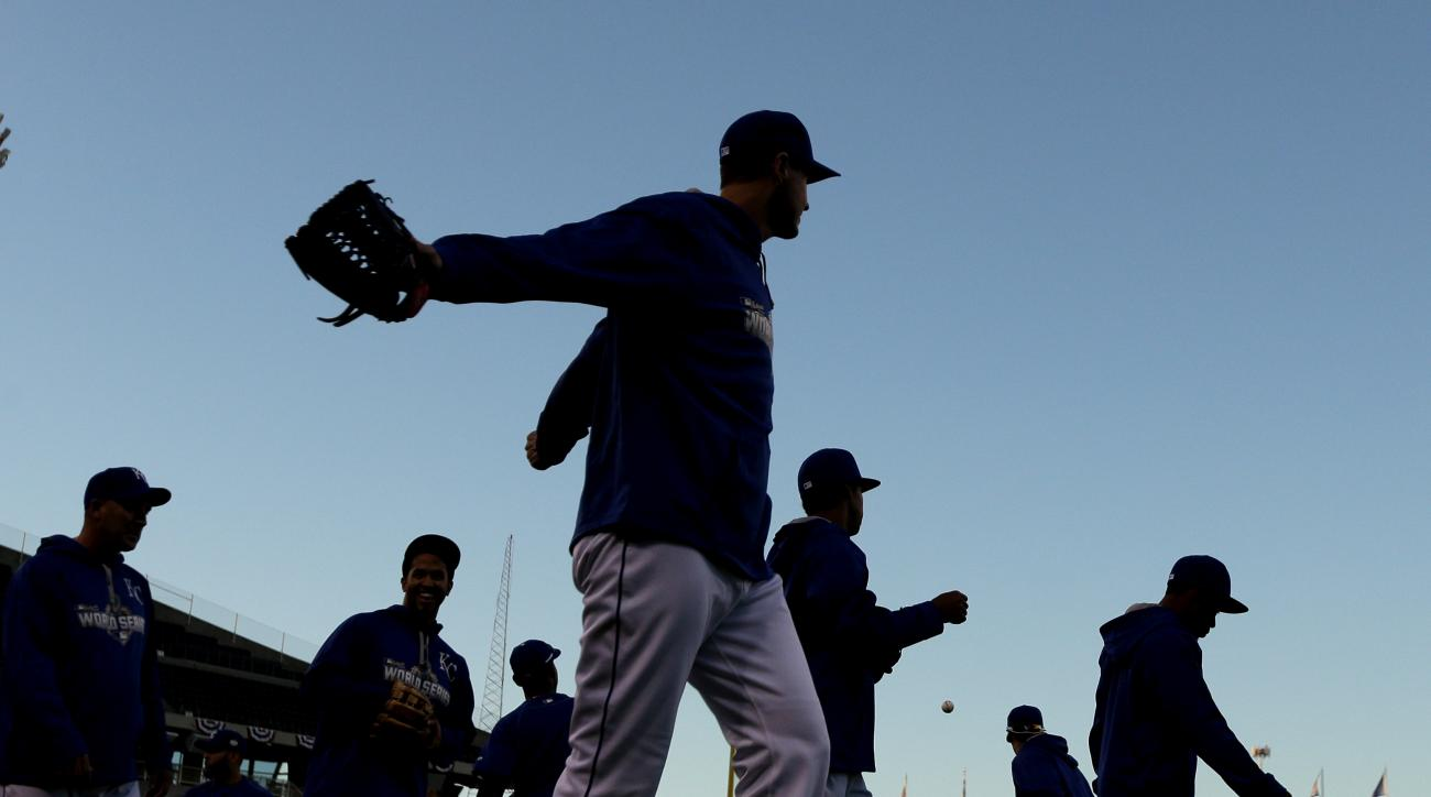 Kansas City Royals players warm up during a baseball workout Sunday, Oct. 25, 2015, in Kansas City, Mo. The Royals will face the New York Mets in Game 1 of the World Series on Tuesday in Kansas City. (A (AP Photo/Charlie Riedel)