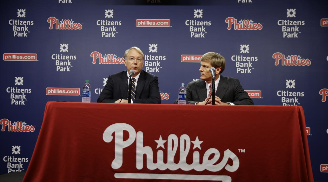 Incoming Philadelphia Phillies president Andy MacPhail, left, and Phillies part-owner John Middleton take part in a news conference Thursday, Sept. 10, 2015, in Philadelphia. The Phillies fired general manager Ruben Amaro Jr. Thursday, with 22 games left