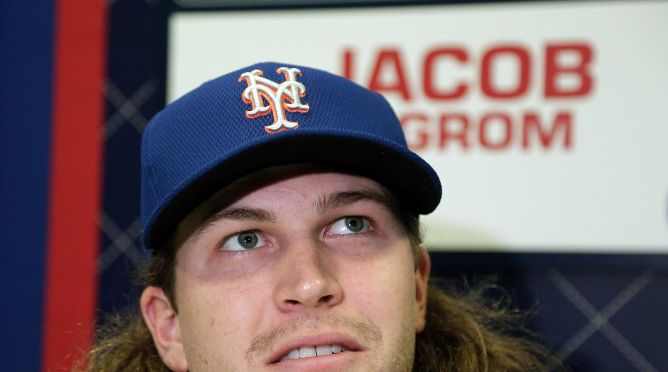 New York Mets starting pitcher Jacob deGrom talks during media day for the Major League Baseball World Series against the Kansas City Royals Monday, Oct. 26, 2015, in Kansas City, Mo. (AP Photo/Charlie Riedel)
