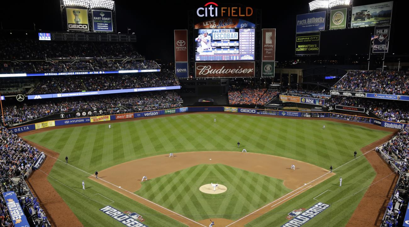 The Kansas City Royals bat against the New York Mets during the first inning of Game 3 of the Major League Baseball World Series Friday, Oct. 30, 2015, in New York. (AP Photo/Peter Morgan)