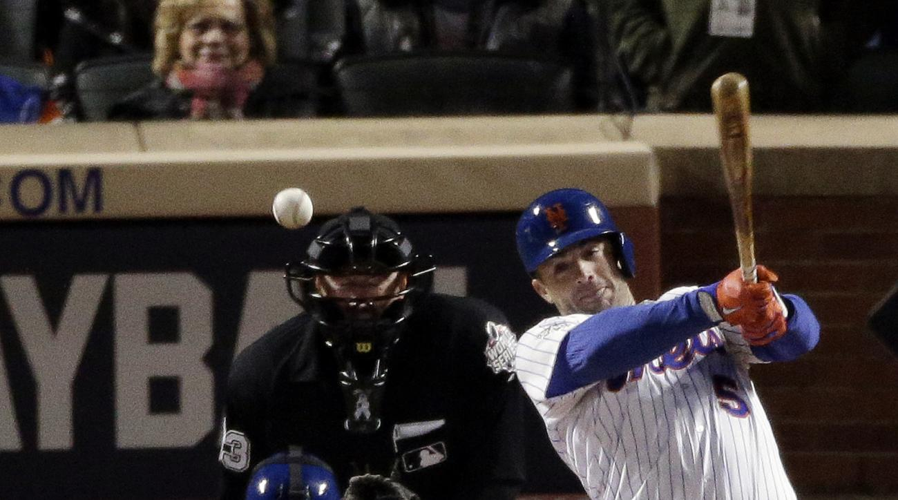 New York Mets' David Wright hit a tow-RBI single against the Kansas City Royals during the sixth inning of Game 3 of the Major League Baseball World Series Friday, Oct. 30, 2015, in New York. (AP Photo/Charlie Riedel)