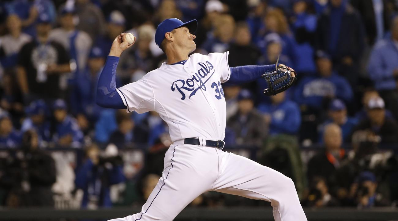 FILE - in this Tuesday, Oct. 27, 2015, file photo, Kansas City Royals pitcher Chris Young throws to a New York Mets batter during the 12th inning of Game 1 of the baseball World Series in Kansas City, Mo. They share the exact shade of blue, expansion era