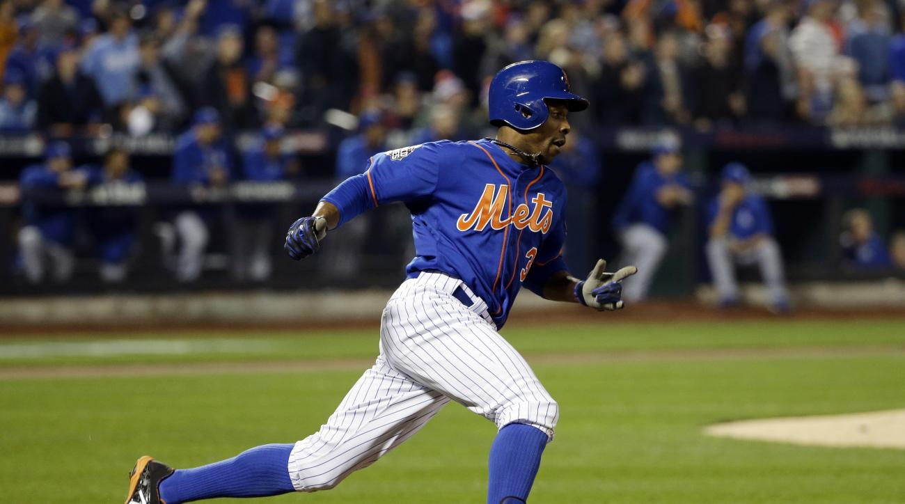 New York Mets' Curtis Granderson rounds the bases after hitting a home run during the first inning of Game 5 of the Major League Baseball World Series against the Kansas City Royals Sunday, Nov. 1, 2015, in New York. (AP Photo/David J. Phillip)