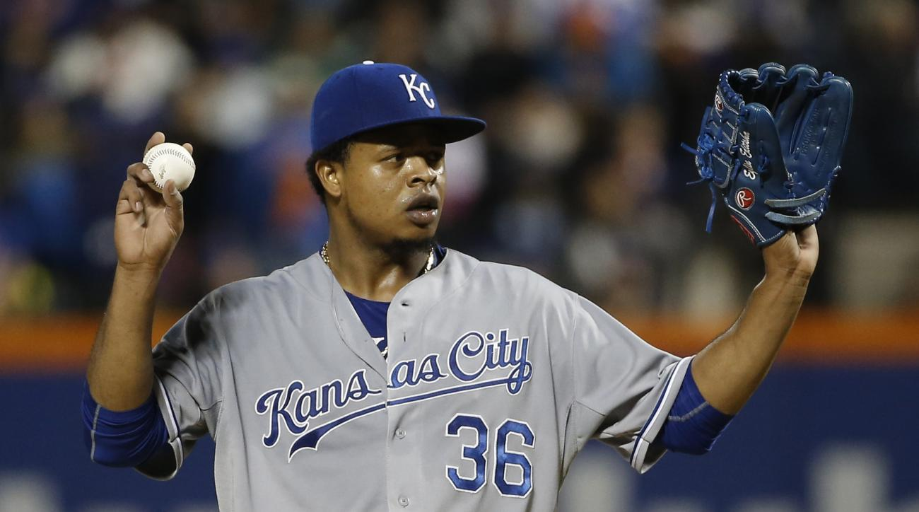 Kansas City Royals pitcher Edinson Volquez holds up his baseball during the fifth inning of Game 5 of the Major League Baseball World Series against the New York Mets Sunday, Nov. 1, 2015, in New York. (AP Photo/Matt Slocum)
