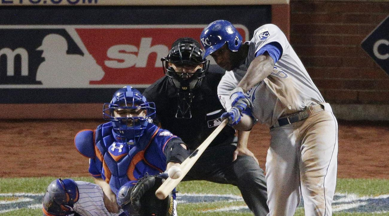 Kansas City Royals' Lorenzo Cain hits a three run double against the New York Mets during the 12th inning of Game 5 of the Major League Baseball World Series Monday, Nov. 2, 2015, in New York. (AP Photo/Charlie Riedel)