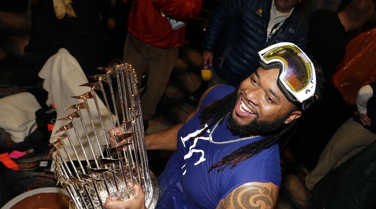 Kansas City Royals' Johnny Cueto celebrates after Game 5 of the Major League Baseball World Series against the New York Mets Monday, Nov. 2, 2015, in New York. The Royals won 7-2 to win the series. (AP Photo/David J. Phillip)