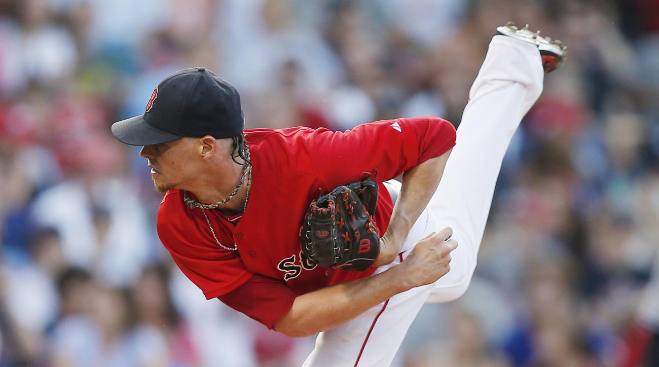 Boston Red Sox's Clay Buchholz pitches during the first inning of a baseball game against the New York Yankees in Boston, Friday, July 10, 2015. (AP Photo/Michael Dwyer)